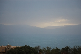 Sunrise over Dead sea during a dust storm
